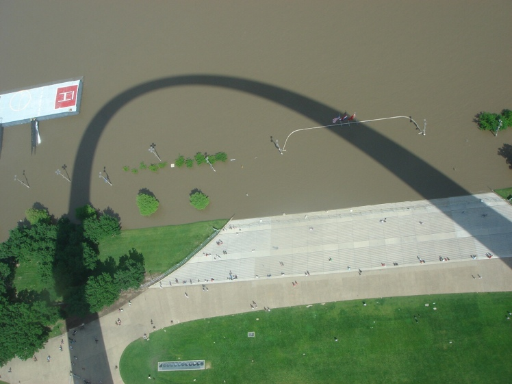 Mississippi River flooding and Gateway Arch shadow